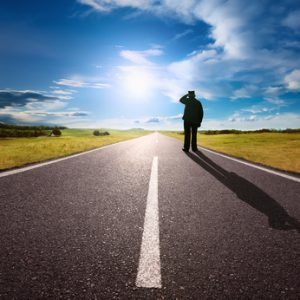 Man stands alone on the road